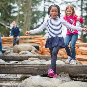 girls running on rocks
