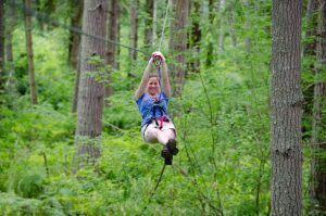 Woman gliding on zipline.