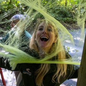 young woman and fake spider web