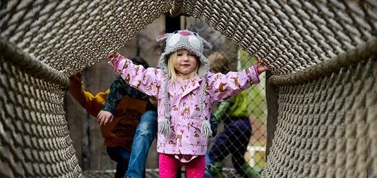 girl on rope bridge explore hero