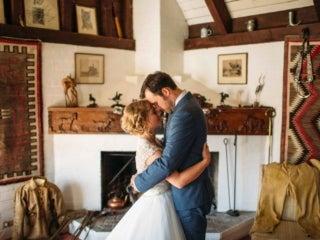 Wedding couple inside cottage