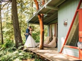 Wedding couple outside cottage