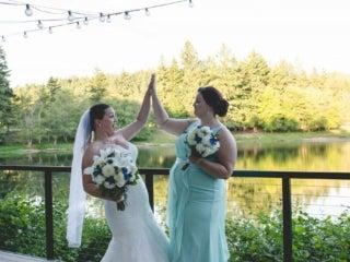 Wedding bride and bridesmaid by lake
