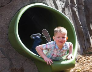 Boy in slide for field trip