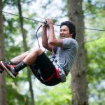 Man laughing on Zip Wild zipline at Northwest Trek