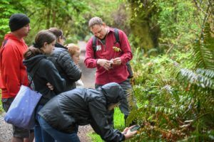 Trek horticulturalist Jake Pool guiding volunteers at the BioBlitz.