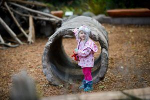 girl in tunnel at Kids Trek