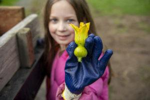 girl holding pumpkin flower