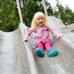girl on slide at kids trek