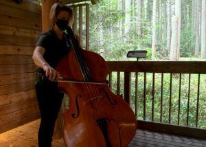 bass player near forest