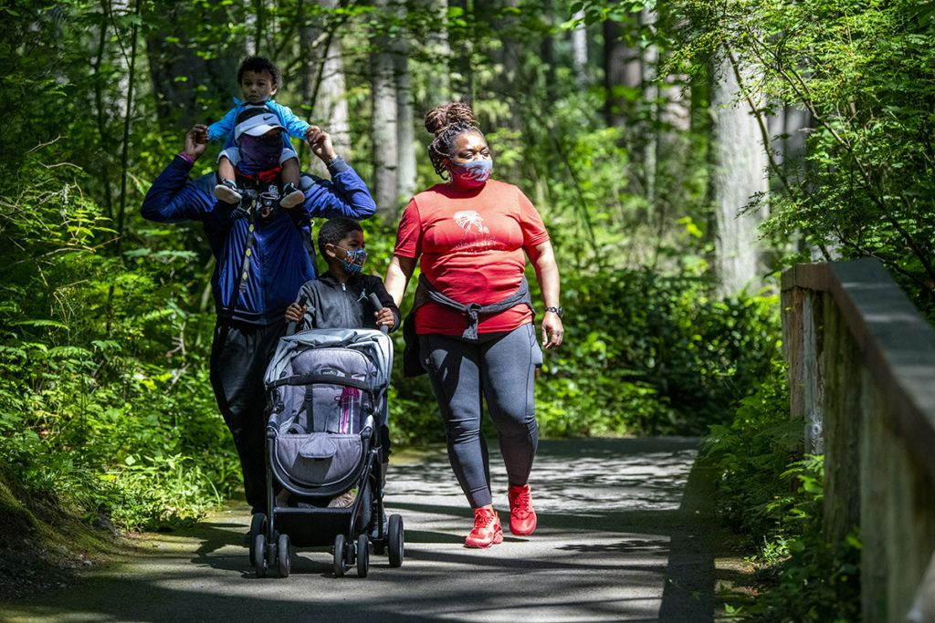family stroller masks walking