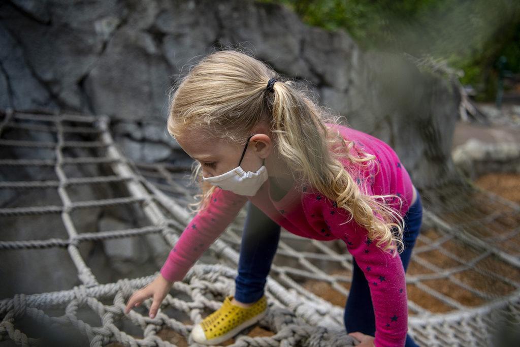 kids trek girl climbing ropes pink