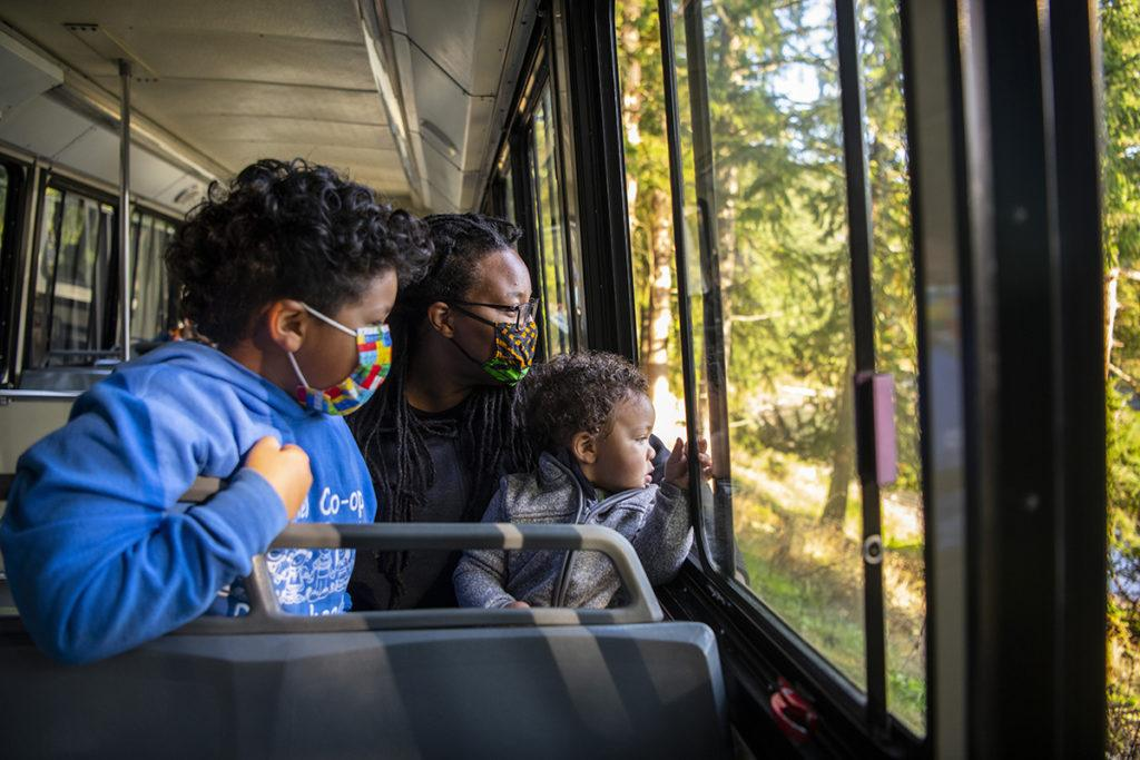 family in tram with masks