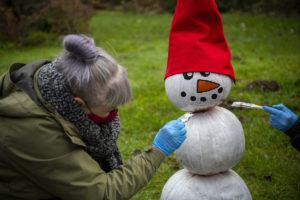 woman painting snowman