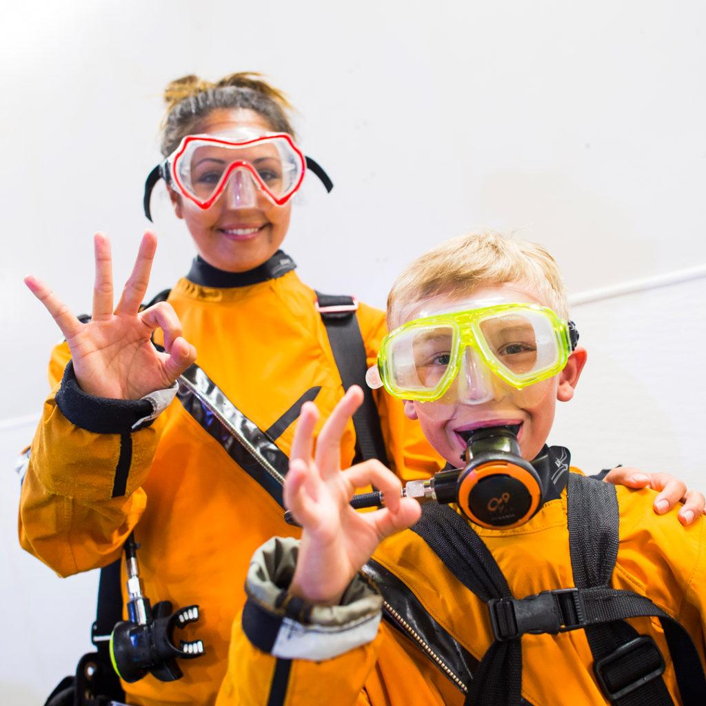 mom and son get ready for shark dive