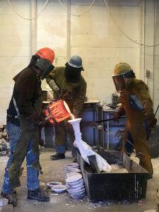 pouring bronze sculpture